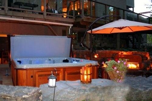arctic spas hot tub and patio umbrella