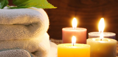 Burning candles with towels